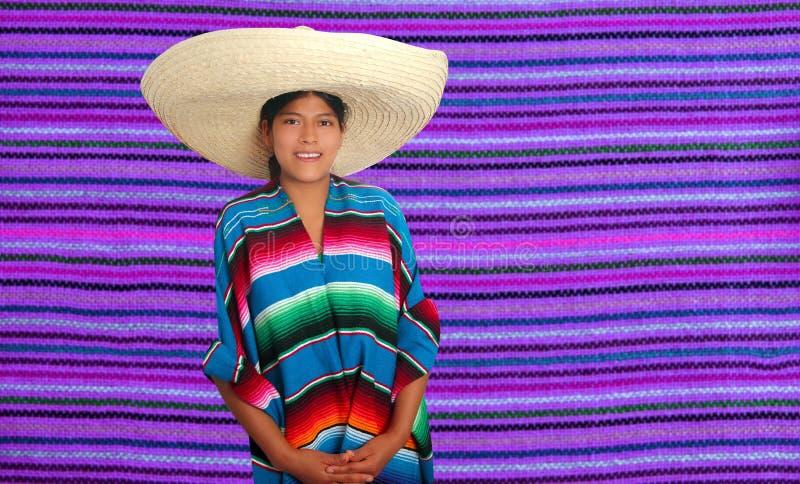 Latin mexican hispanic sombrero poncho woman. Over serape purple background royalty free stock photo