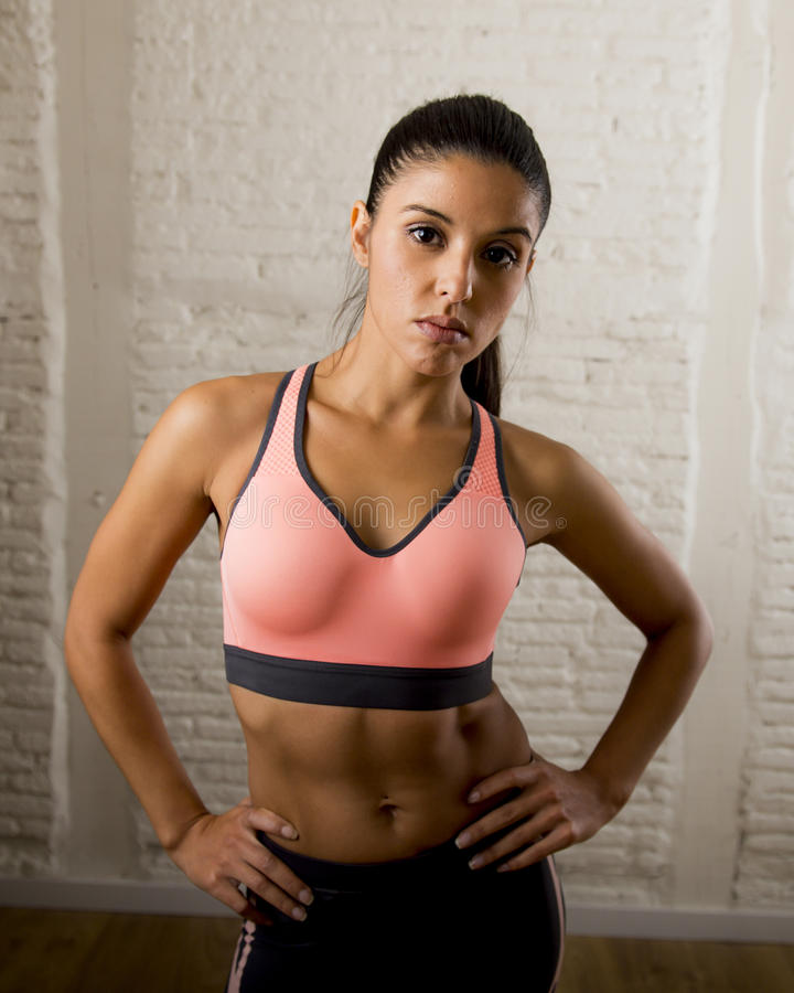 Latin sport woman posing in fierce and badass face expression with fit slim body stock photo