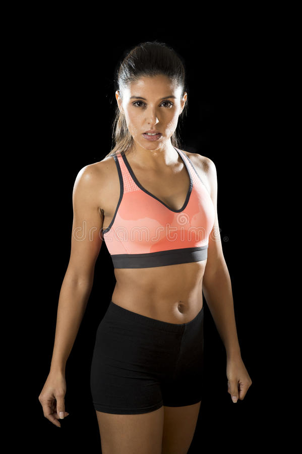 Latin sport woman posing in fierce and badass face expression with fit slim body stock photography