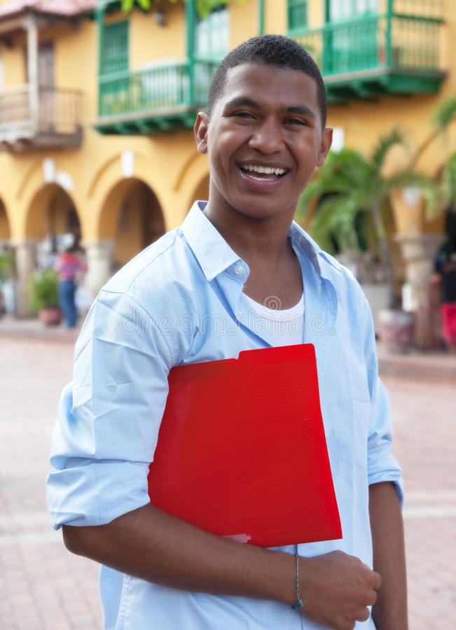 Latin student in a colonial town walking to university royalty free stock image