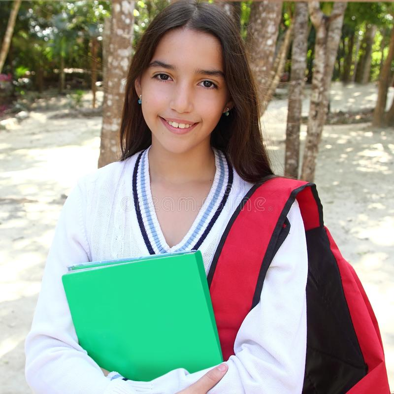 Latin teenager girl backpack in Mexico park royalty free stock photography