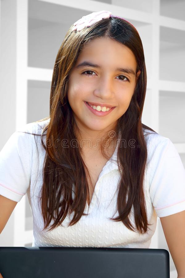 Latin teenager student smiling holding laptop royalty free stock images
