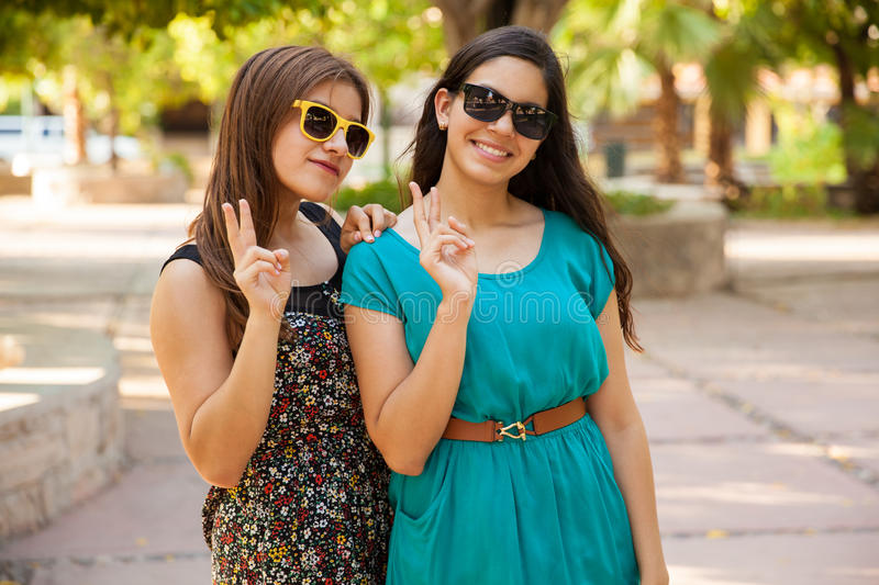 Latin teens with peace signs stock image