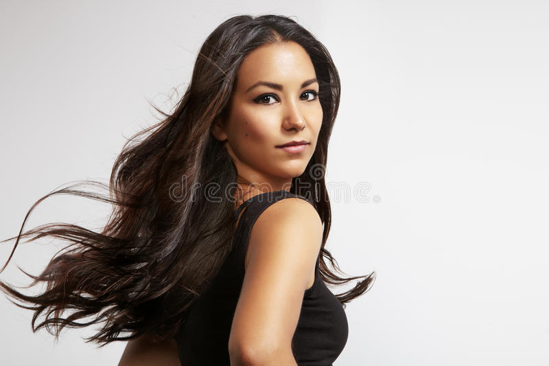 Latin woman with blowing hair. Portrait of a latin woman with blowing windy hair royalty free stock images