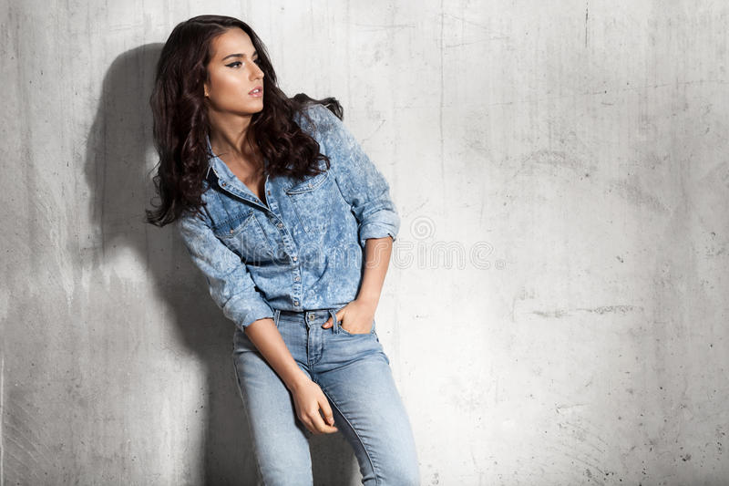Latin woman in jeans and a denim shirt royalty free stock photography