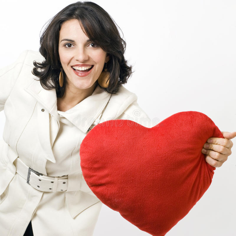 Latin woman with red heart royalty free stock photo