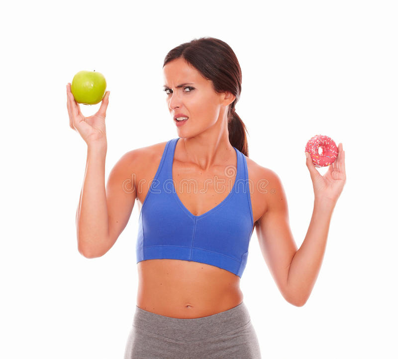 Latin woman in sport clothing looking confused stock images