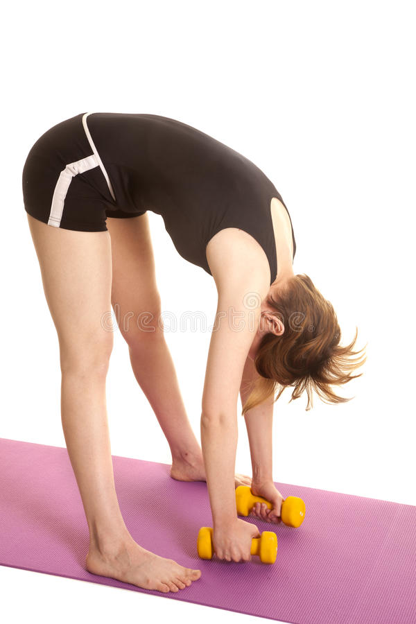 Latin woman yellow weights bend down royalty free stock photos
