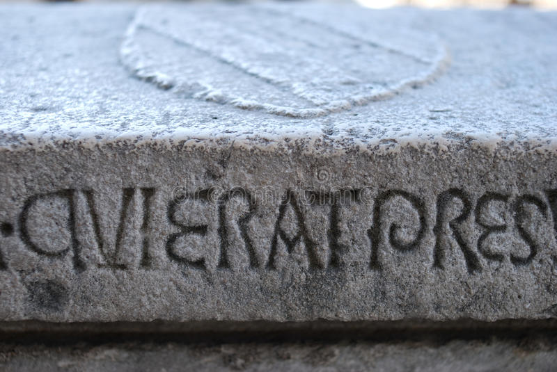 Carved Stone Slab : Latin writing carved into a stone slab stock photo