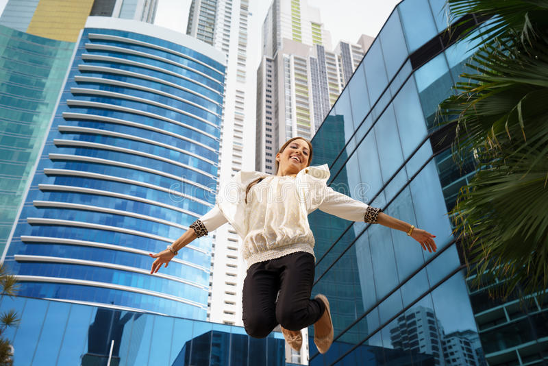 Latina business woman jumping joy happy office smile stock photos