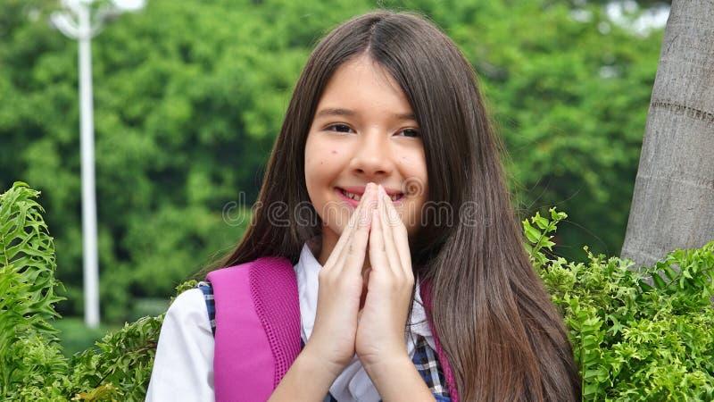 Latina dziewczyny ucznia modlenie fotografia royalty free