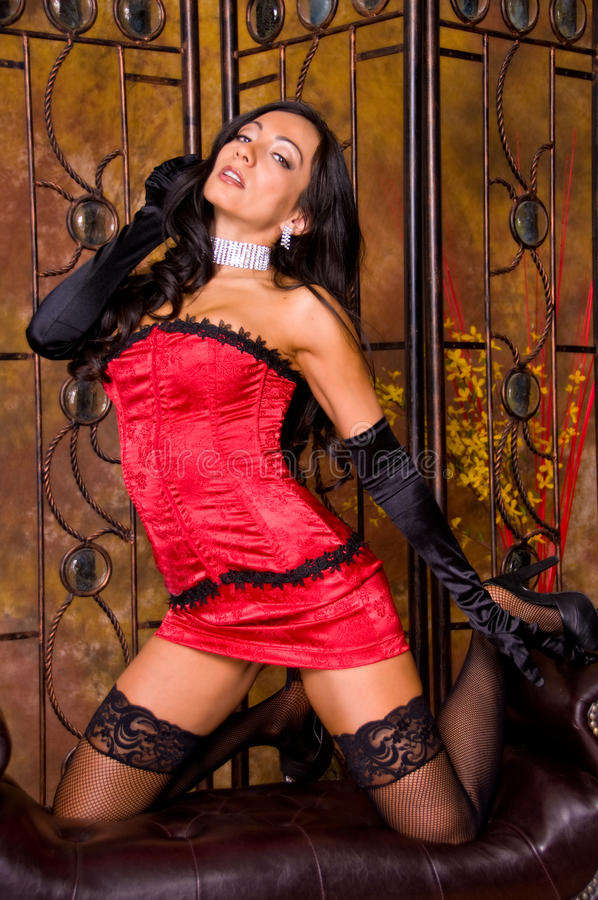 Latina sexy in corsetto immagine stock