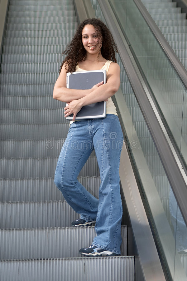 Latina Student Hugging on Escalator royalty free stock images