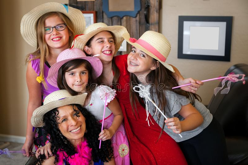 Latina Woman With Curly Black Hair Poses With Young Girls All In stock image