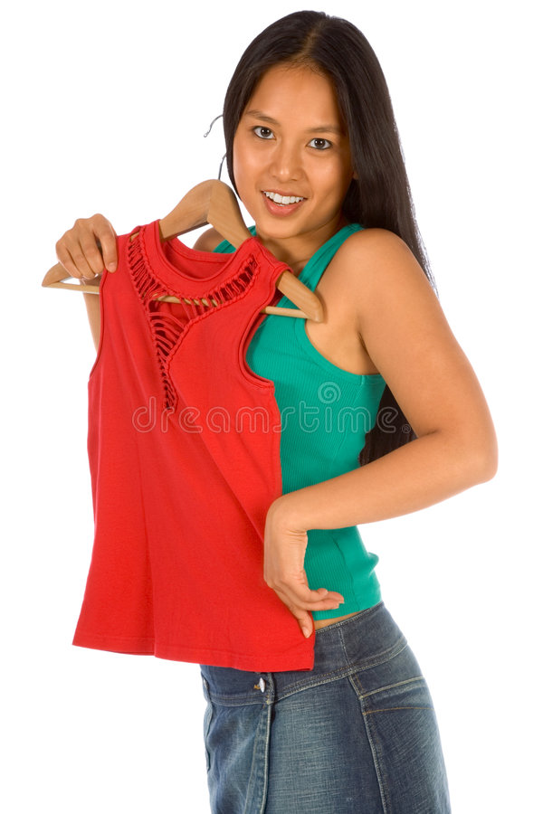 Free Latina Woman Not Sure Should I Buy This Red Shirt Royalty Free Stock Photo - 2981745