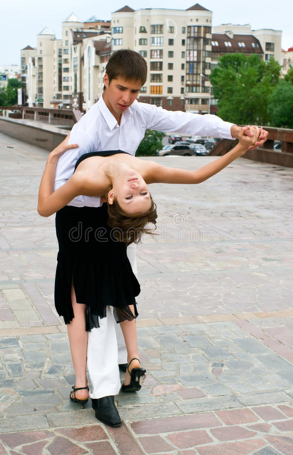 Latino dance against urban landscape royalty free stock photos