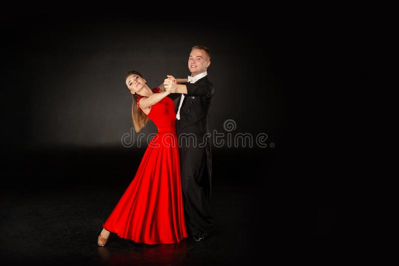 Latino dancers in action. Beautiful couple on grey background stock photo