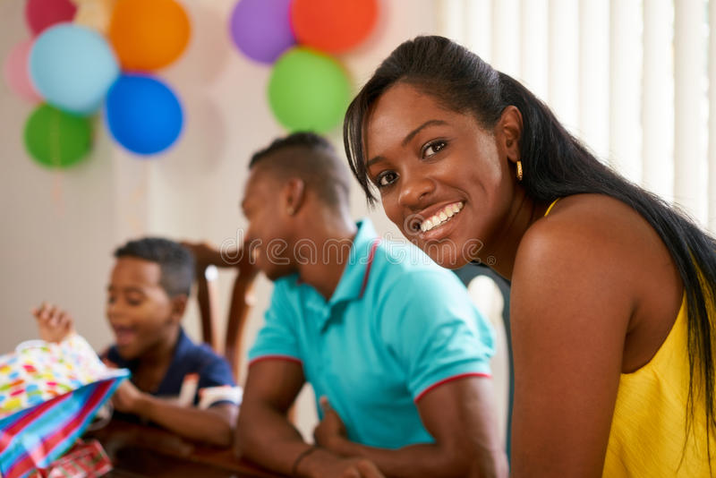 Latino Family With Man Woman Child Celebrating Birthday At Home royalty free stock image