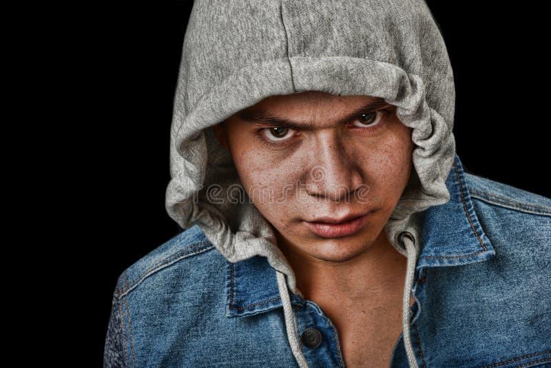 Latino Gang Member. Very striking Image of a very angry latino Youth stock photography
