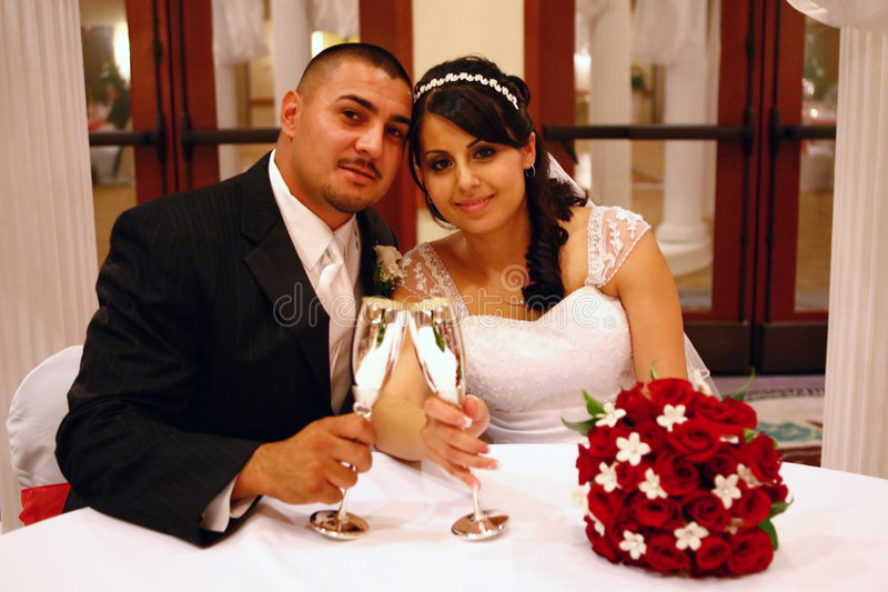 Latino Wedding Couple Toasting stock photos