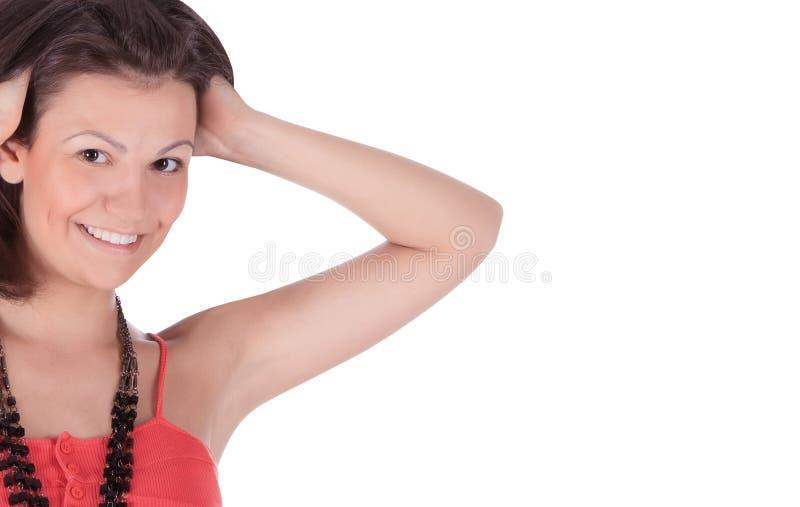 latino wijfje in het rode kleding stellen over wit stock afbeelding