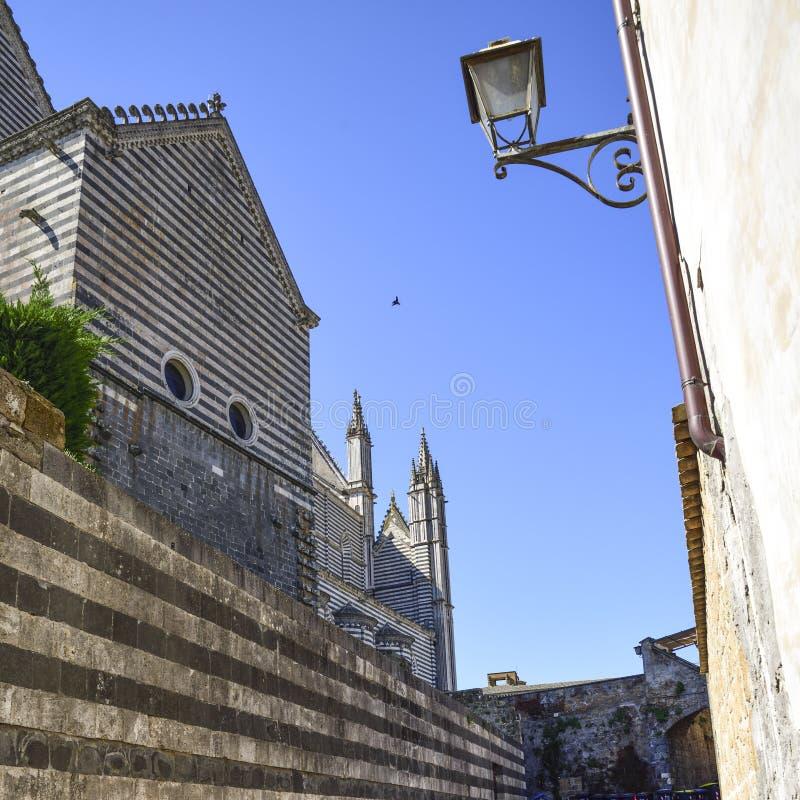 Lato posteriore della cattedrale di Orvieto, Italia uno può osservare il Th fotografia stock