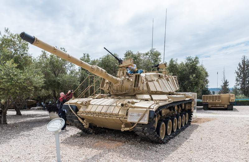 The visitor takes pictures of the child in the tank on the Memorial Site near the Armored Corps Museum in Latrun, Israel stock image