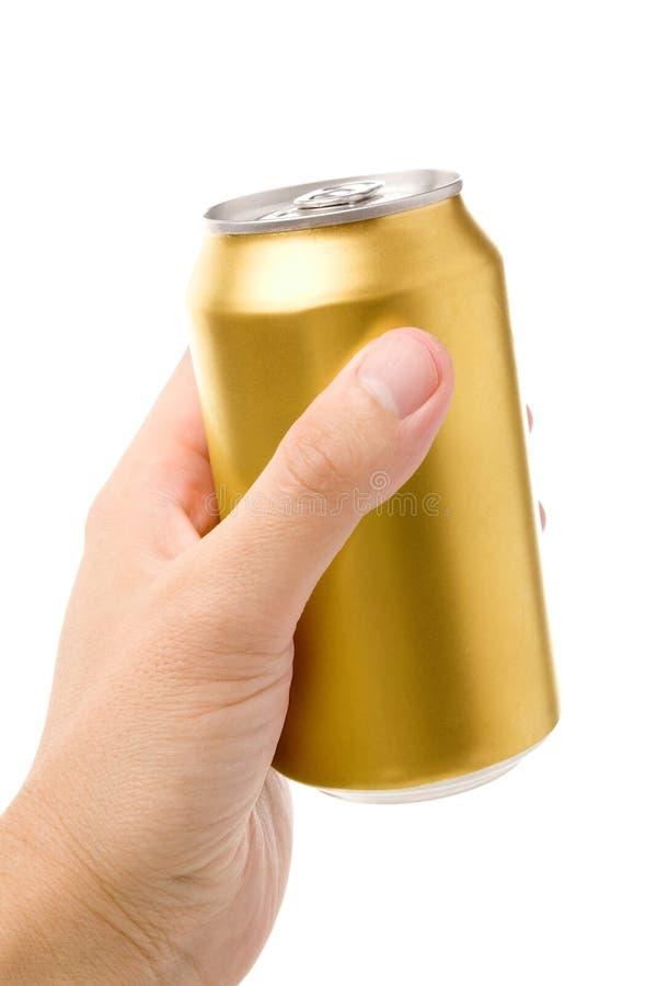 Latta di soda in bianco dorata immagini stock libere da diritti