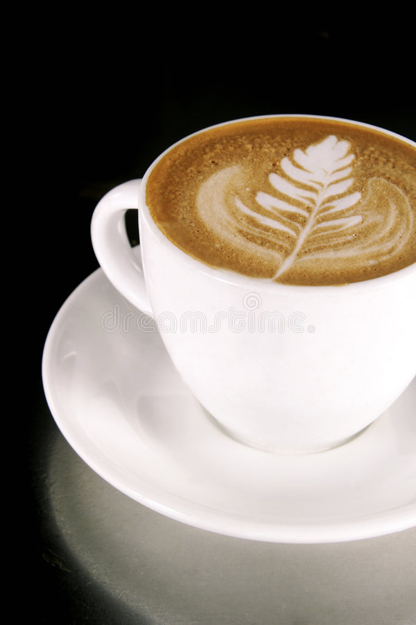 Latte Art. On a Cappucinno royalty free stock images