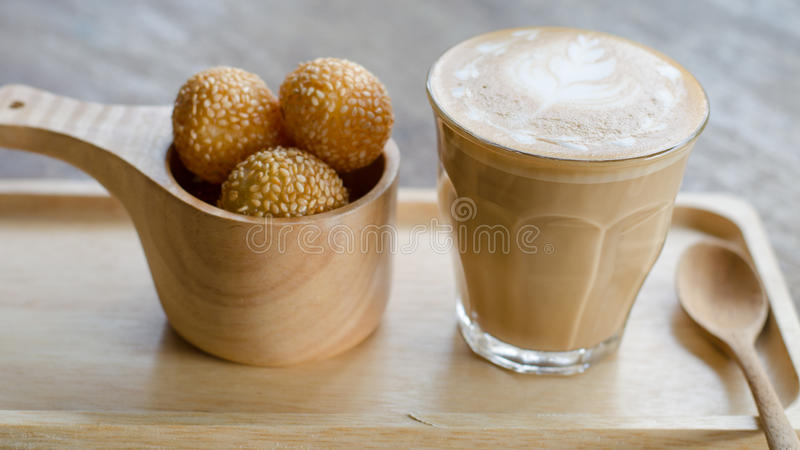 Latte art coffee and candy eggs swan. A glass of hot latte art coffee and candy eggs swan royalty free stock image