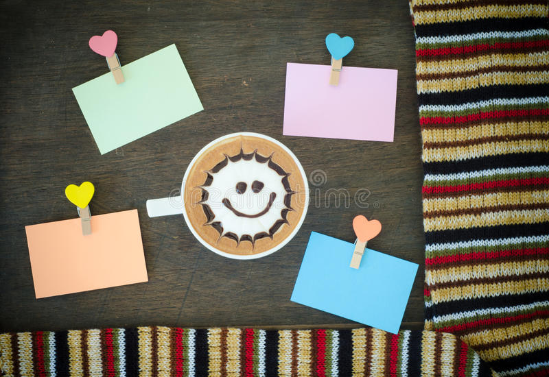 Latte art coffee and clip note. On wooden background stock photography