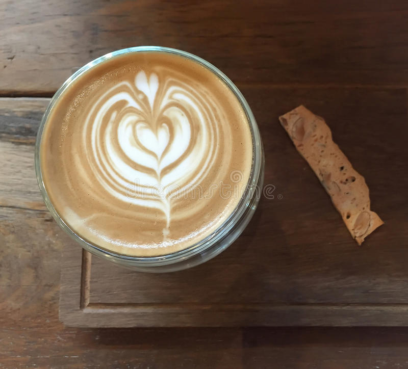 Latte art coffee and cookie snack royalty free stock photos