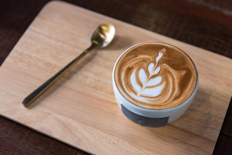 Latte art coffee cup heart shape topping and spoon stock images