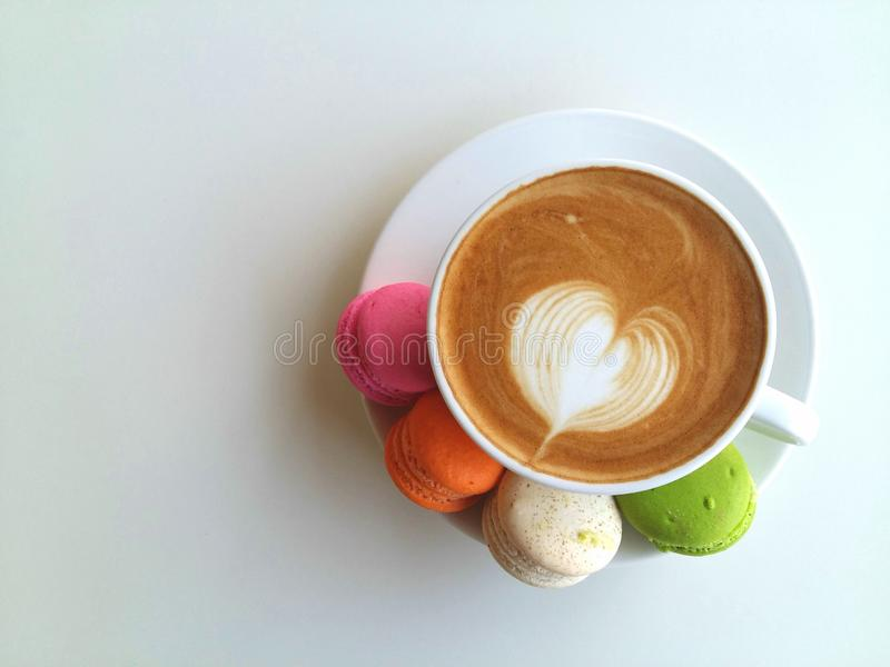 Latte art coffee so delicious with macaroon on white royalty free stock photo