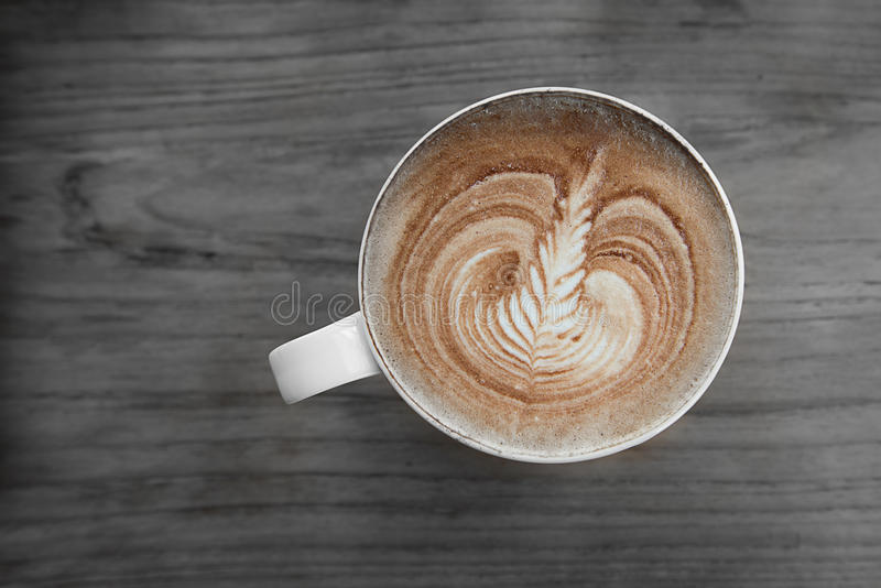 Latte art coffee. Over wooden background stock photo