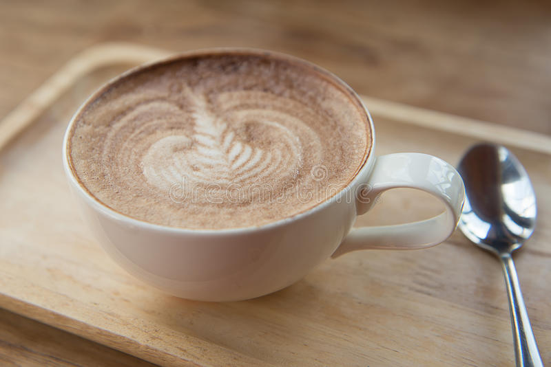 Latte art coffee. Over wooden background stock photos