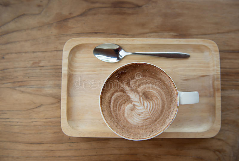 Latte art coffee. Over wooden background royalty free stock photography
