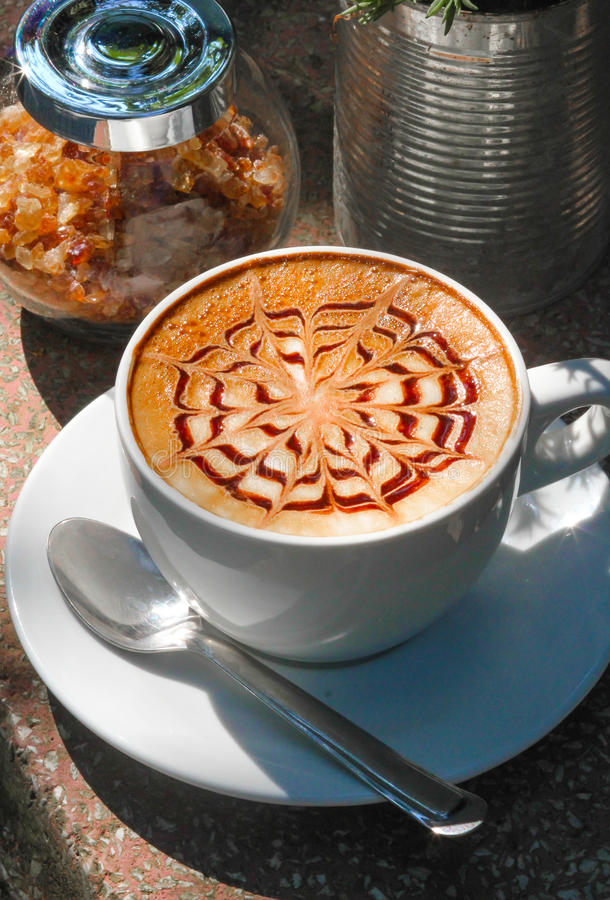 Latte Art. Cup of coffee , Cup of latte art in the garden royalty free stock photography