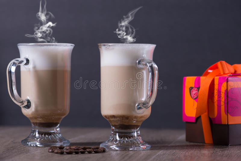 Latte coffe glass with beans and meringue royalty free stock photo