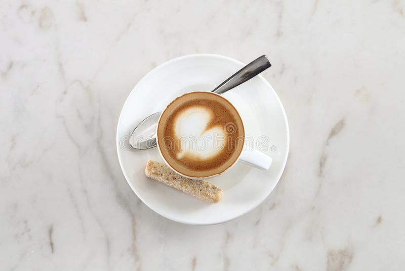 Latte coffee art. Latte coffee cup on marble background stock image