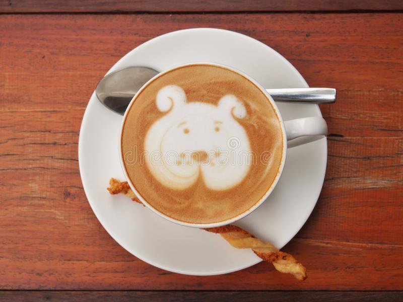 Cute Dog Face Latte Art Coffee In White Cup On Wooden Table Stock ...