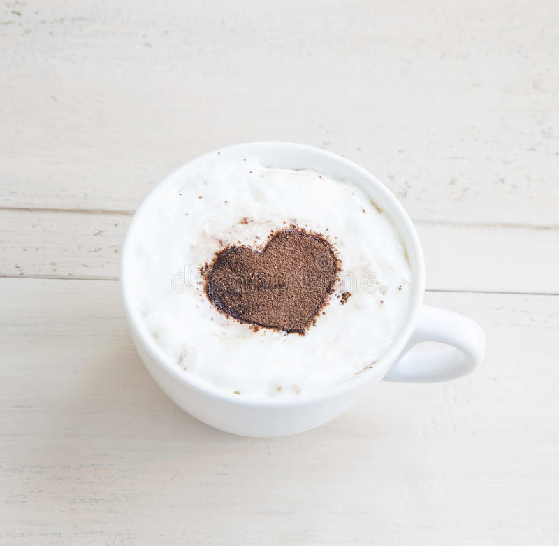 Latte Coffee Cup with Cocoa Heart Shape royalty free stock photography
