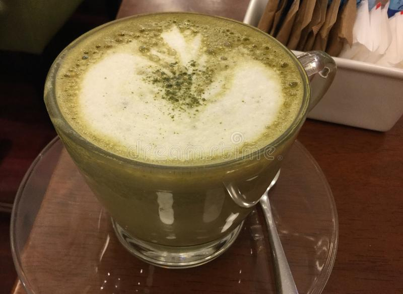 Matcha Green Latte. A latte is a coffee drink made with espresso and steamed milk. The term as used in English is a shortened form of the Italian caffè latte royalty free stock photo
