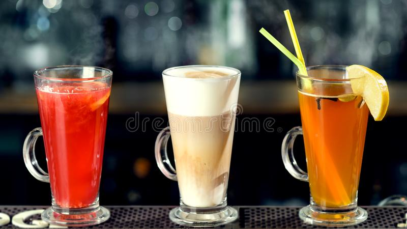Latte and hot alcoholic cocktails at the bar counter. Cinema eff. Ect royalty free stock images