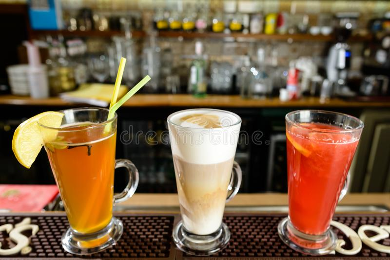 Latte and hot alcoholic cocktails at bar counter. Latte and hot alcoholic cocktails at the bar counter royalty free stock photos