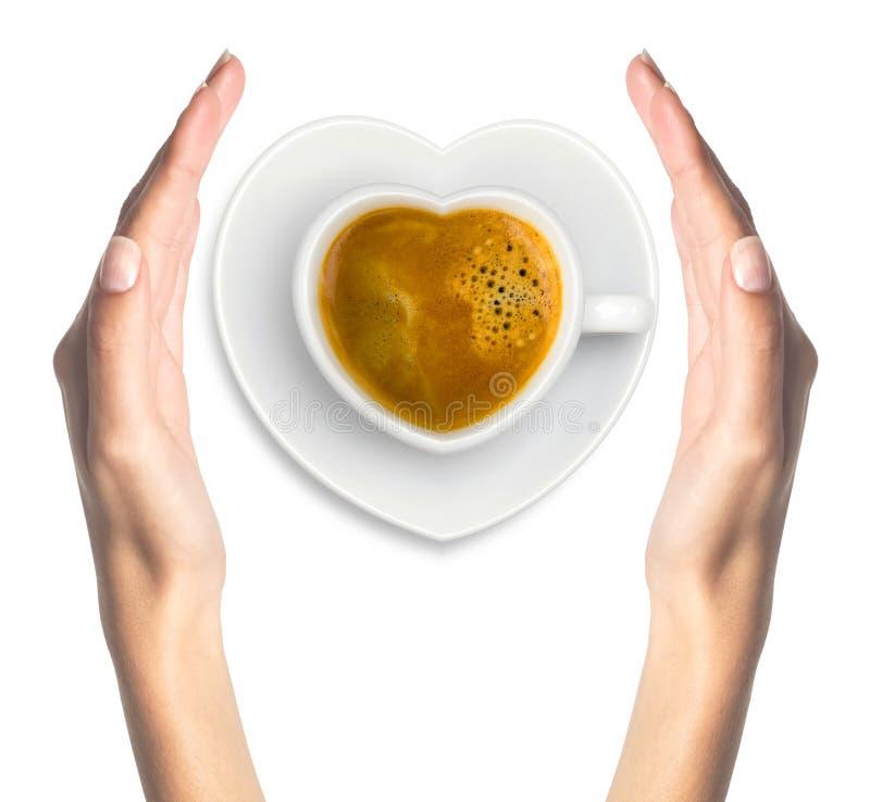 Latte kawa z kierowym symbolem i kobietą wręcza odosobnionego na bielu obraz stock