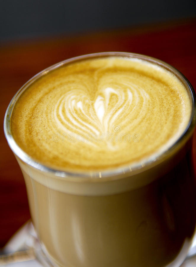 Latte Love Heart Coffee. Latte coffee art featuring a love heart royalty free stock photos