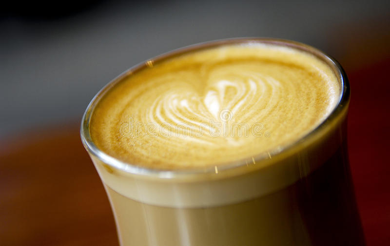 Latte Love Heart Coffee. Latte coffee art featuring a love heart royalty free stock images
