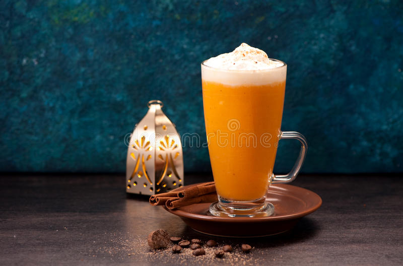 Latte smoothies with spices. Pumpkin latte smoothies with spices and spicy royalty free stock image
