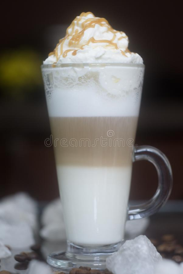 Latte three-layered. Milk coffee cocktail royalty free stock images